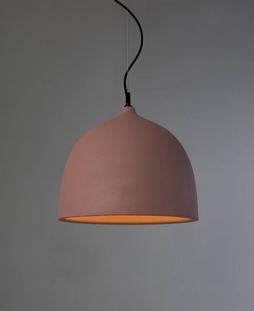 boccia large pink pendant light suspended from black fabric cable against grey background