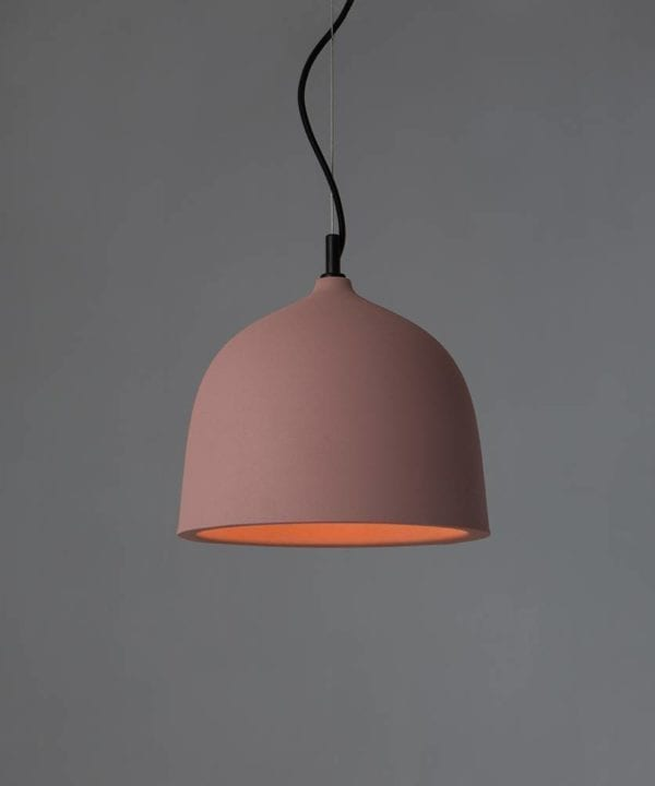 boccia small pink pendant light suspended from black fabric cable against grey background