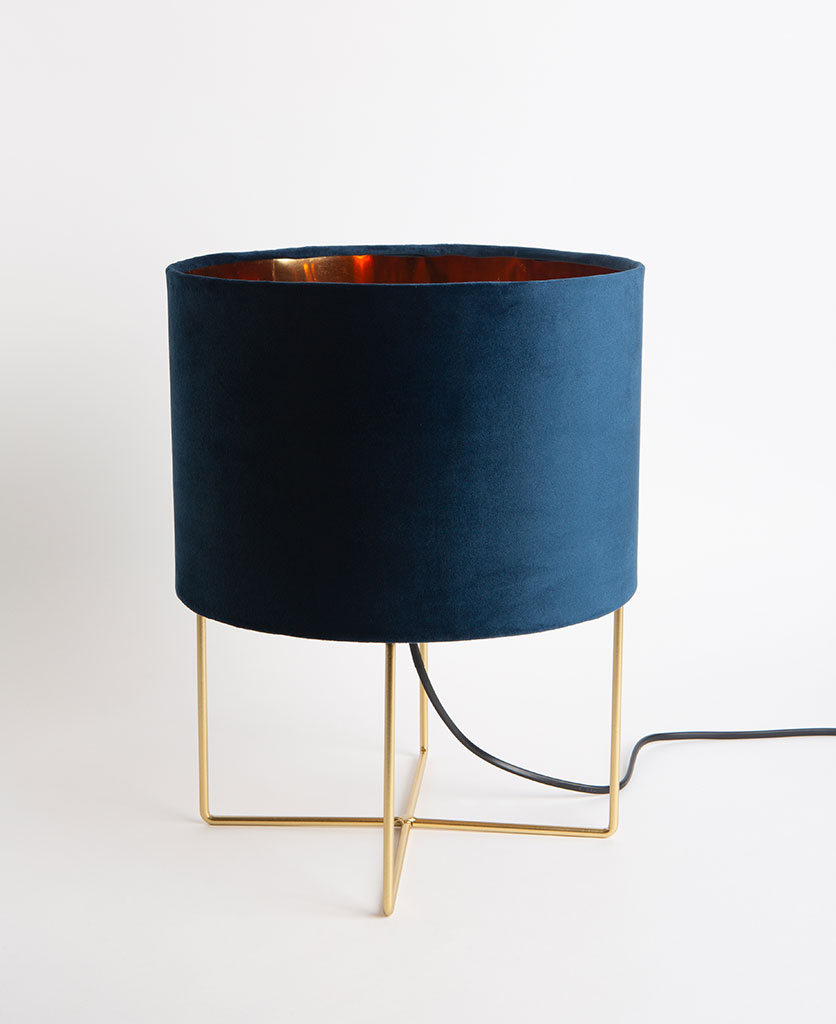Harlow gold table lamp with blue velvet shade on white background