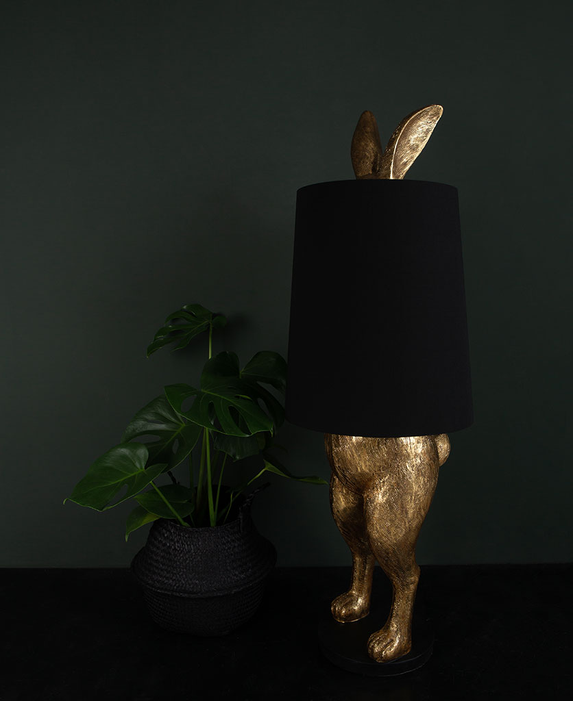 Hartley hare gold floor lamp with black shade on dark background switched off