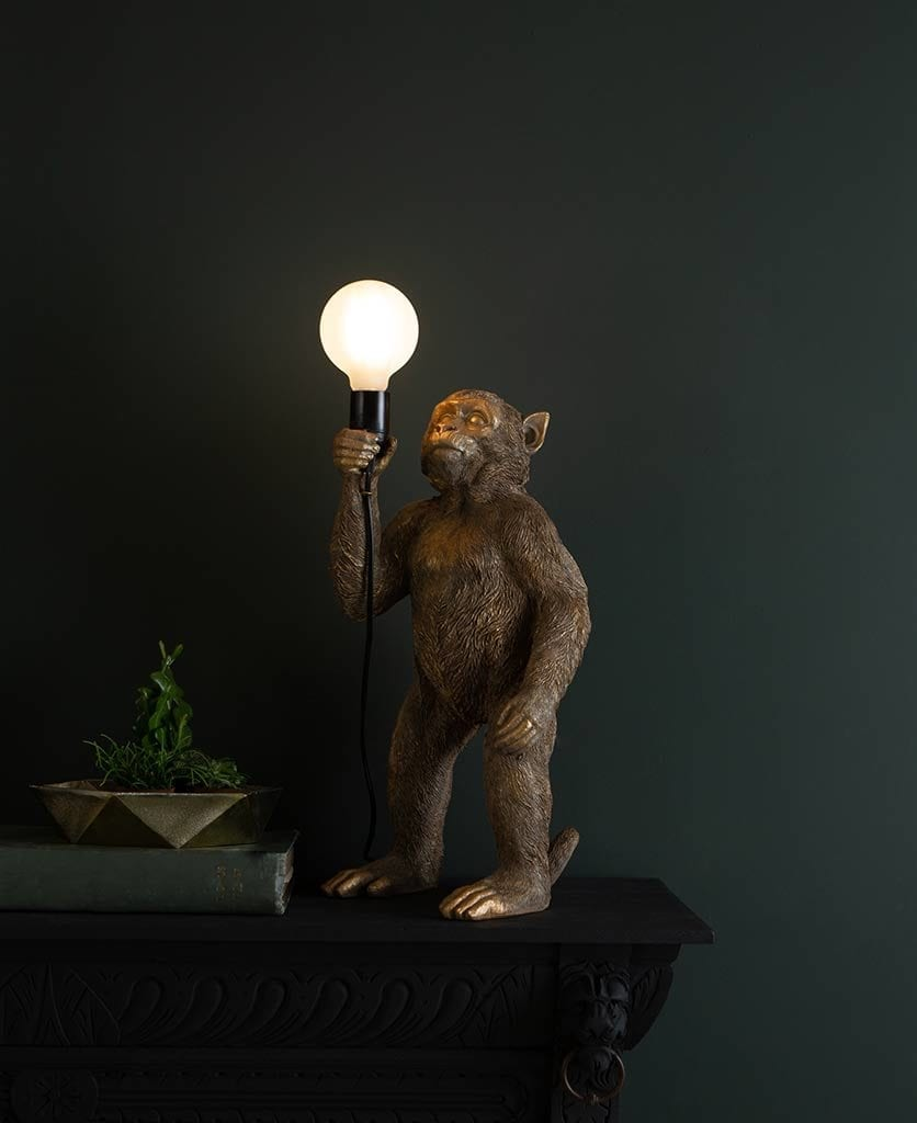 Monty Gold Standing Monkey Table Lamp against black background