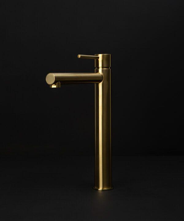 gold inga tap on black background