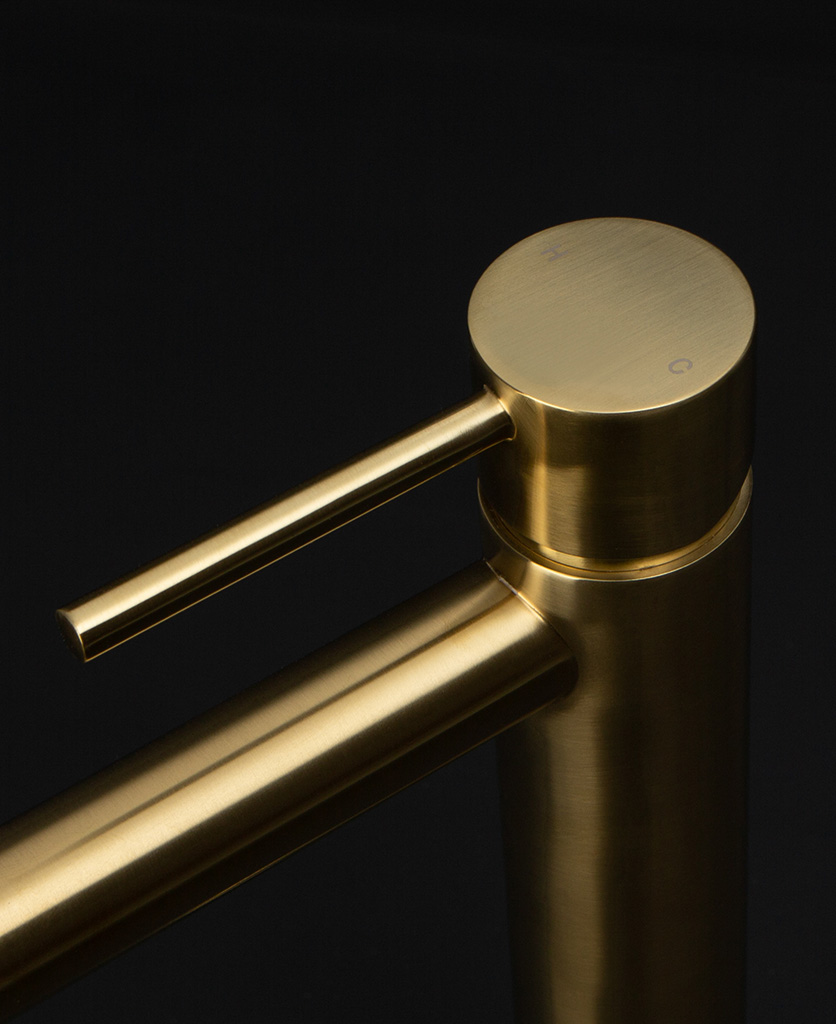 gold inga tap close up of handle hot and cold on black background