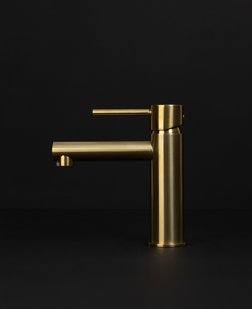 gold kagera tap side angle on black background