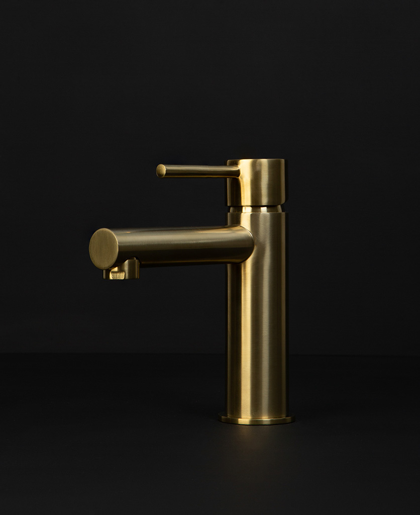 gold kagera tap on black background