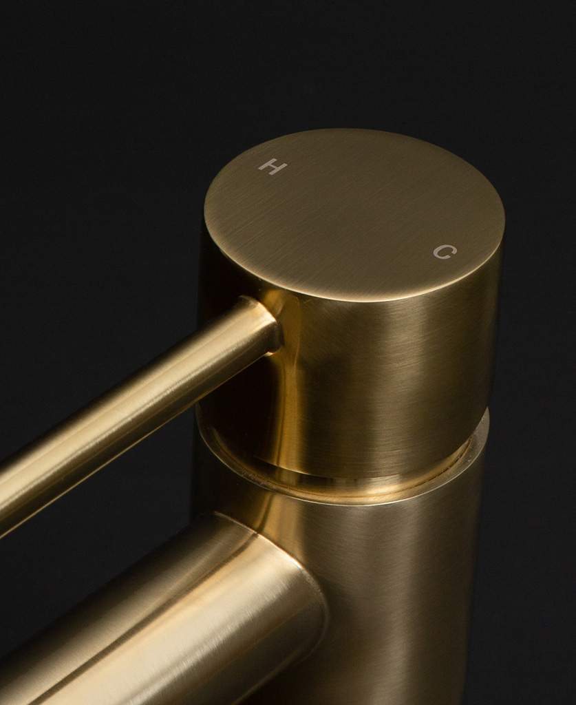 gold kagera tap close up of handle on black background