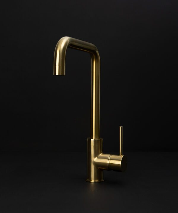 gold kintampo tap on black background