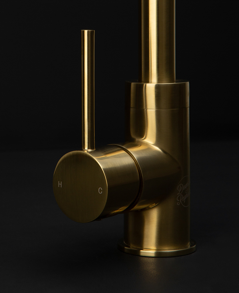 gold kintampo tap close up of handle on black background