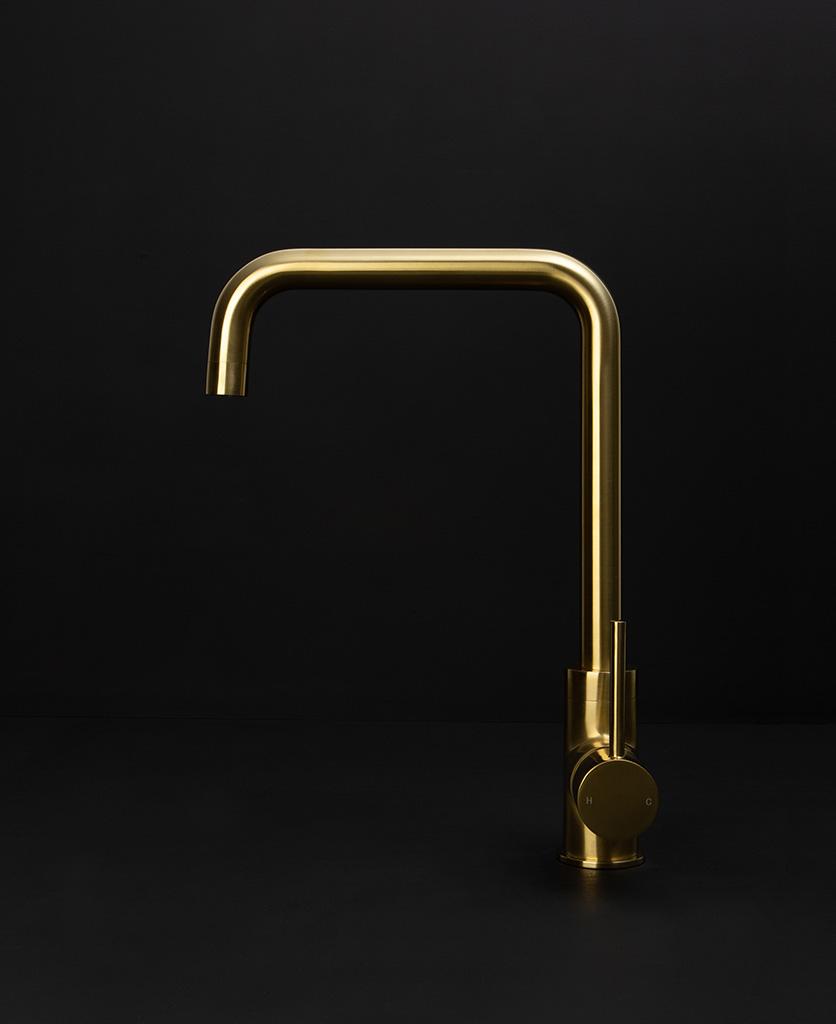 gold kintampo tap side angle on black background