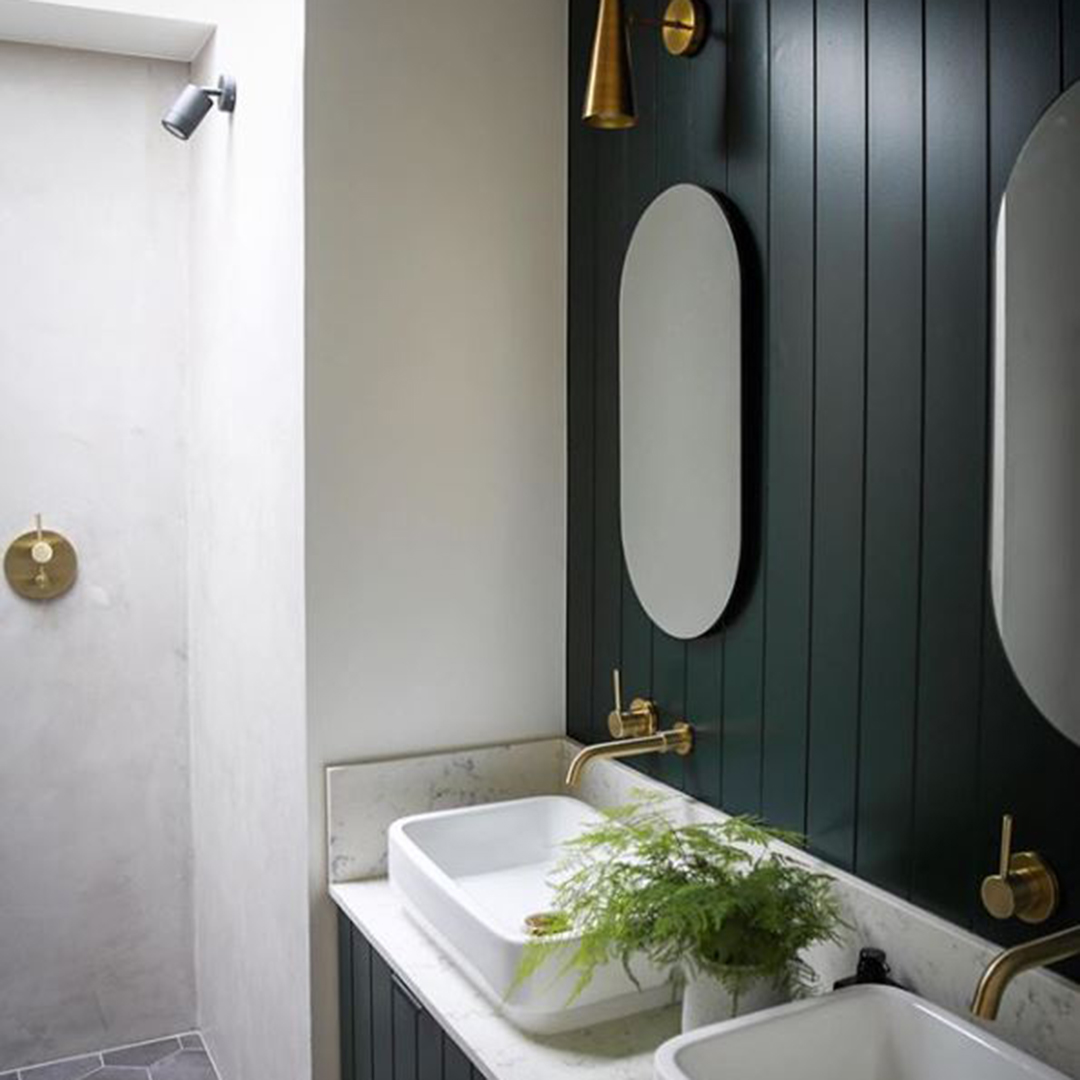 gold jadipai tap above white sink in white and dark grey bathroom