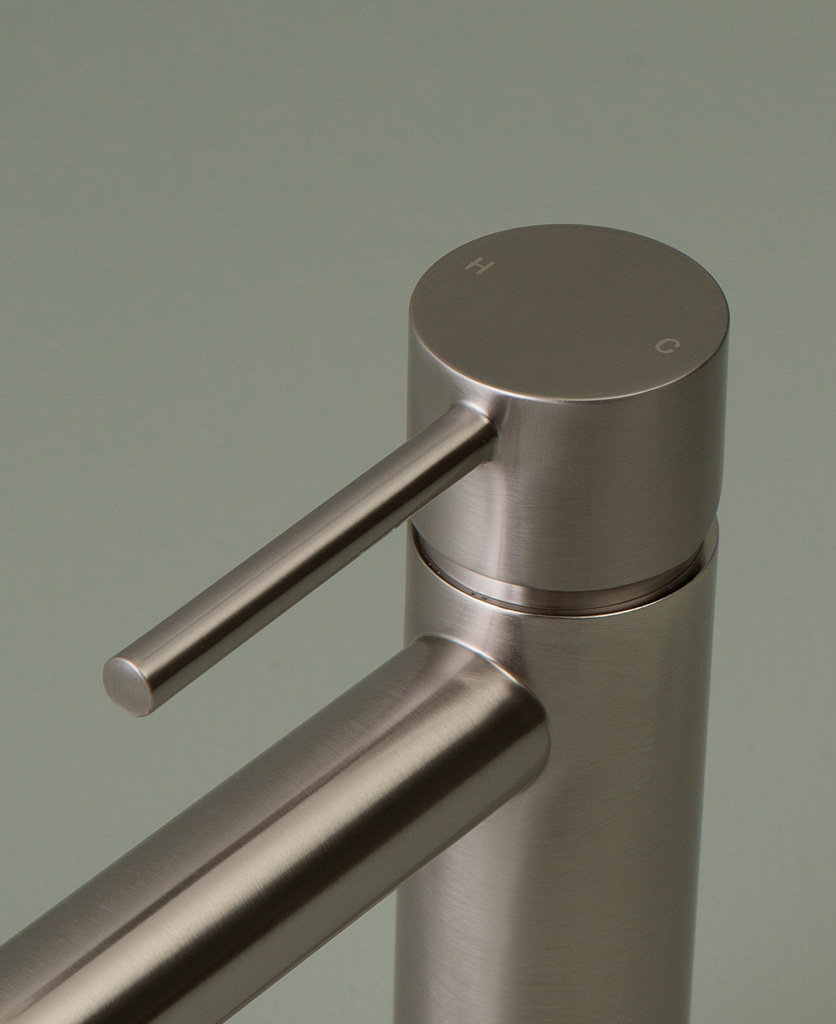 silver kagera tap handle close up on grey-green background