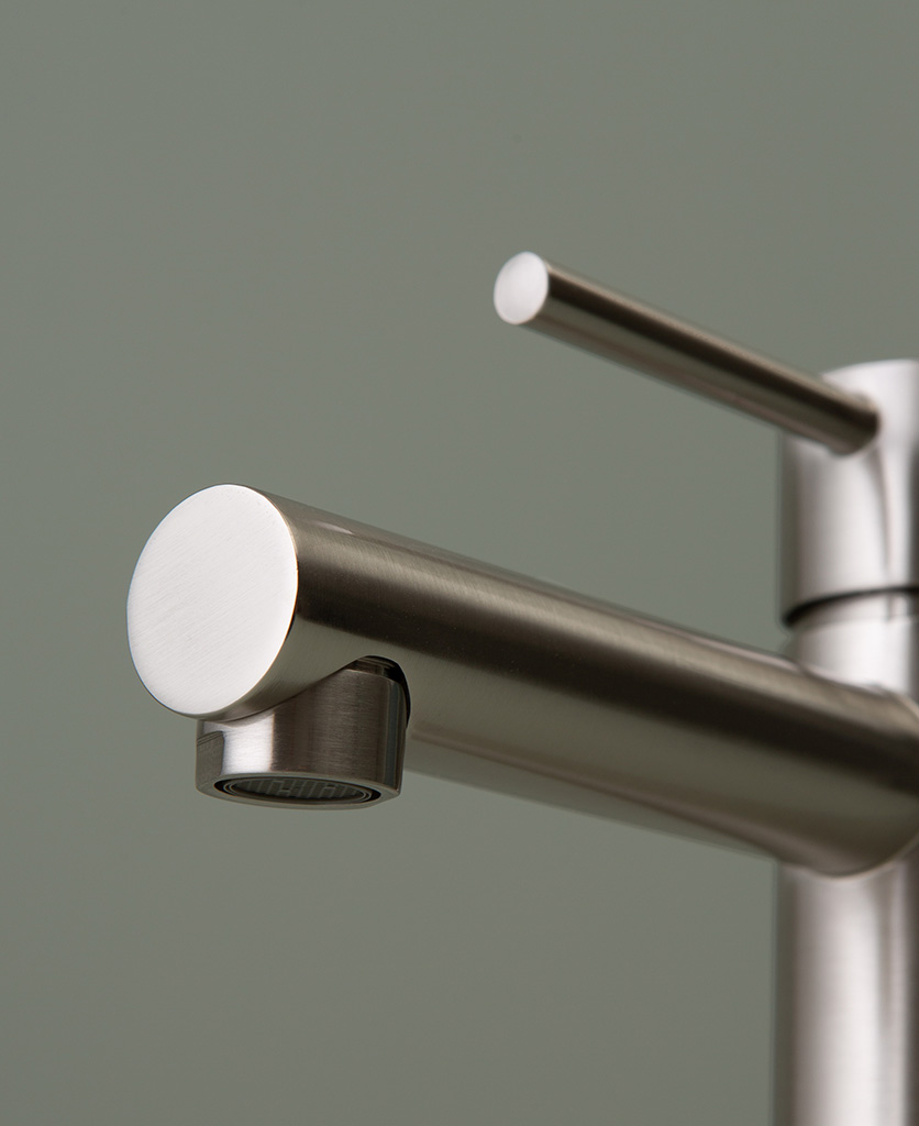 silver kagera tap spout close up on grey-green background