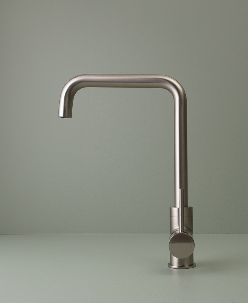 silver kintampo tap side angle shot on grey-green background