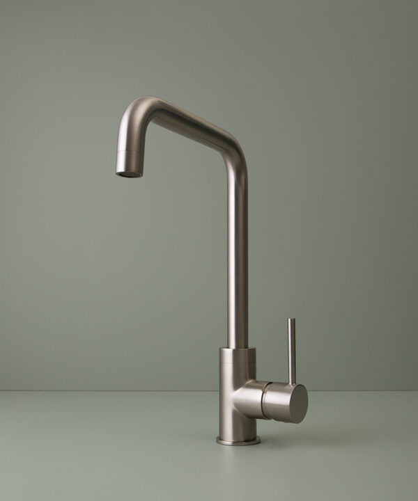 silver kintampo tap on grey-green background