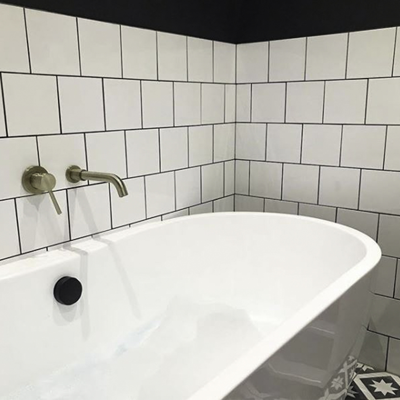 jadipai wall tap in white tiled bathroom