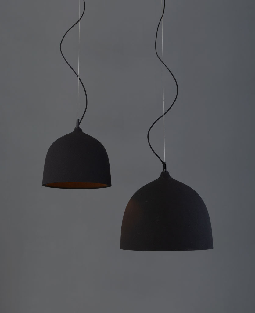 basque black round pendant light two bowl pendants suspended from suspension wire and black fabric cable against grey wall