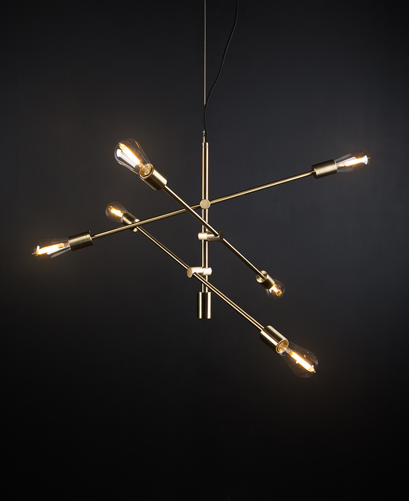 brass feature pendant lights with five clear pear bulbs against black background