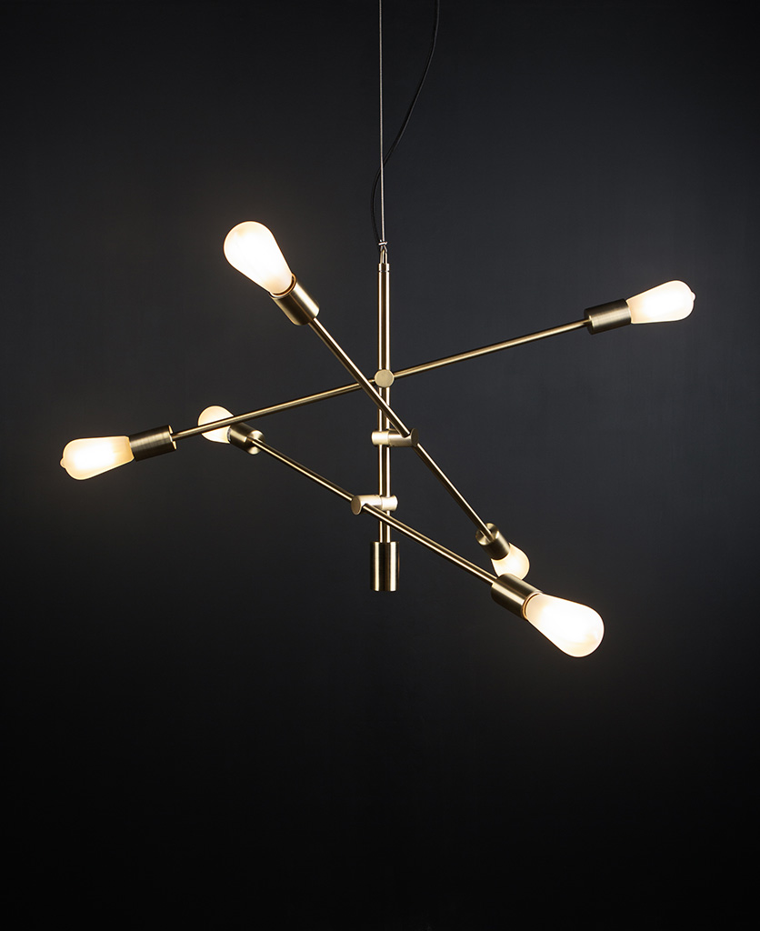 brass feature pendant lights with five frosted pear bulbs against black background