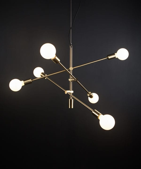brass feature pendant lights with opal bulbs againast black background