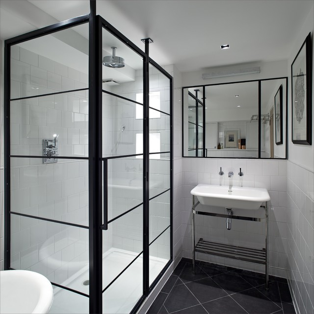 black and white bathroom with black crittal shower screen