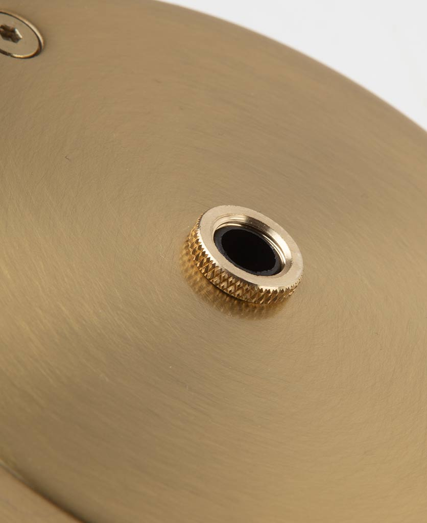 closeup of small raw brass one point ceiling rose against white background