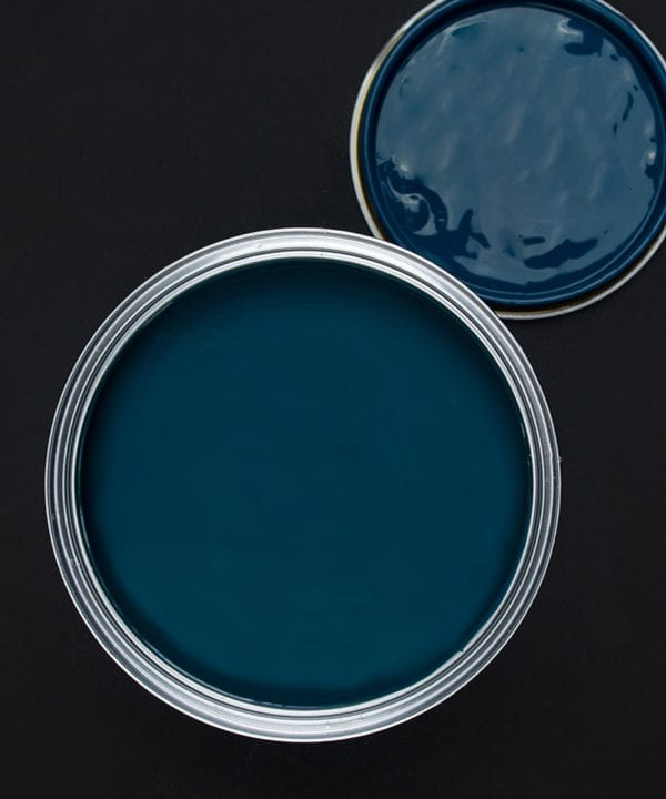 In deep water rich blue paint tin on dark background