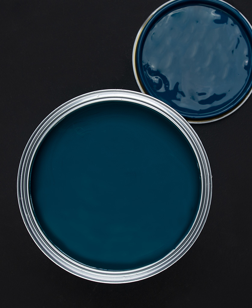 In deep water rich blue paint tin on dark background