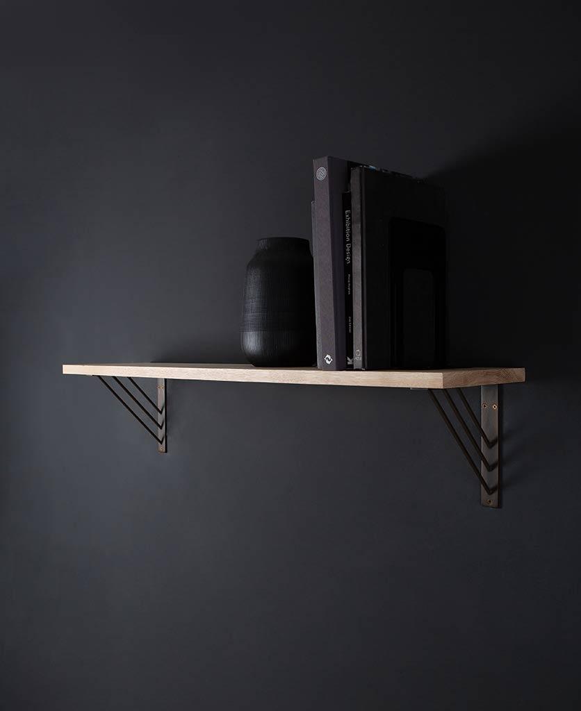 large ingrid shelf and brackets on black background