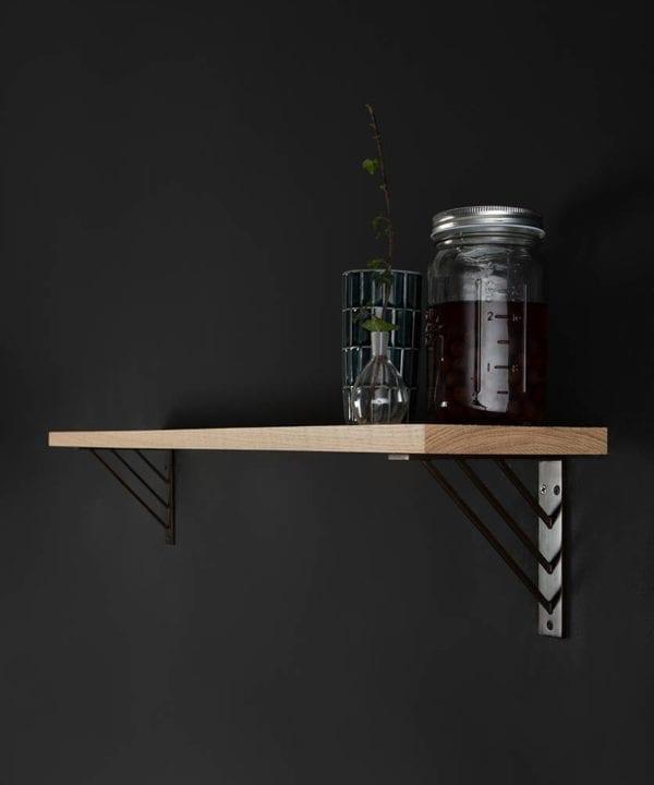 small ingrid oak shelf and brackets on black background