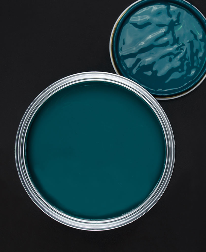 Teal the show blue green paint tin on dark background