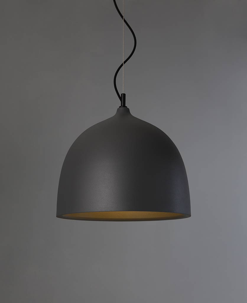 trugo large grey pendant light suspended from black fabric cable against grey background