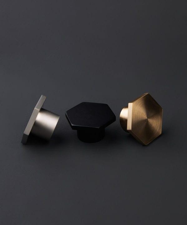 bauhaus furniture drawer handles in black silver and gold against dark grey background