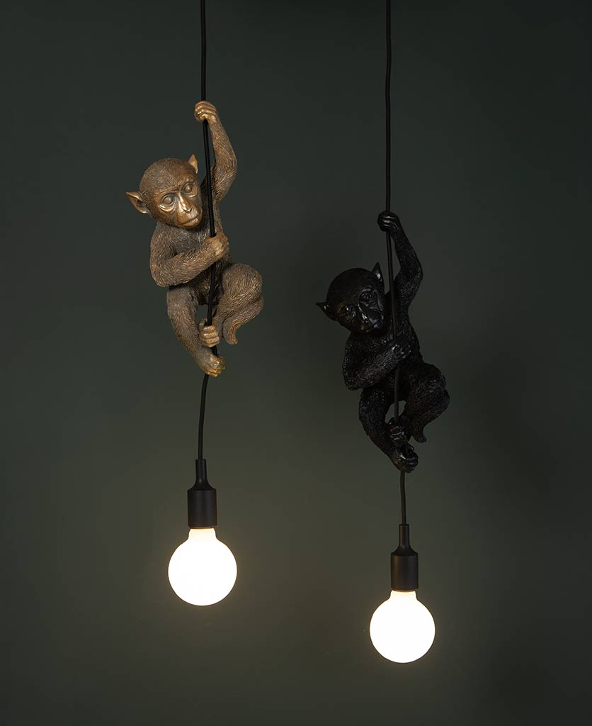 darwin hanging monkey light 2 monkey pendant lights suspended against a black background with bulbs