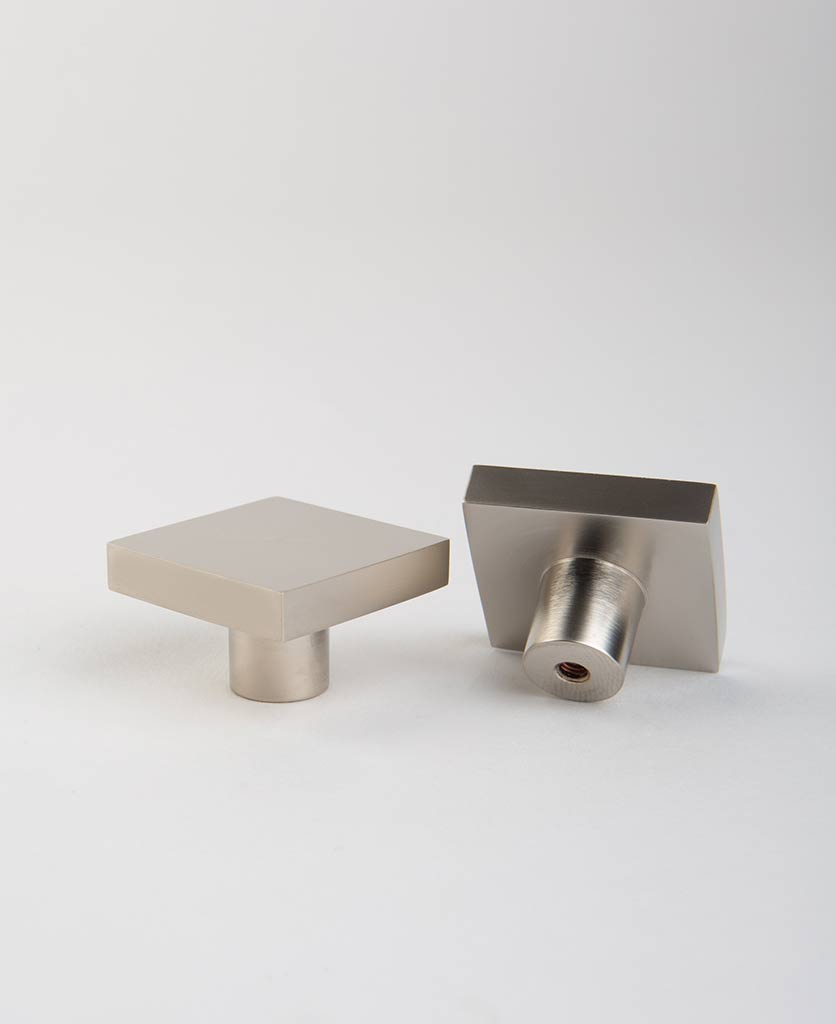 expressionist square silver knobs on white background