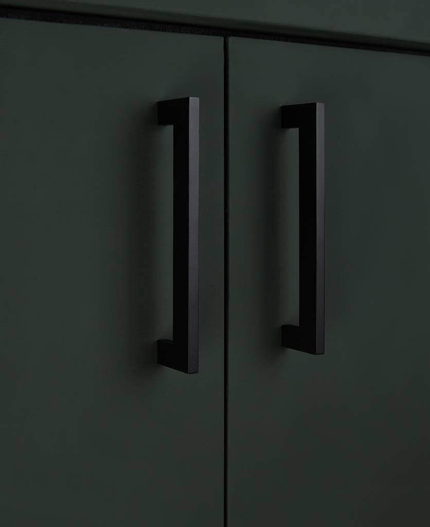gamma 17.6cms black square kitchen door handles on green cupboard