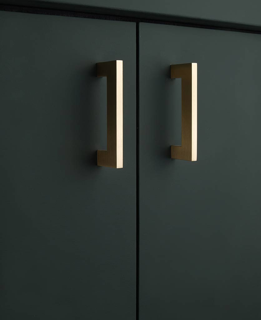 gamma 11.2cms gold square kitchen door handles on dark grey cupboards
