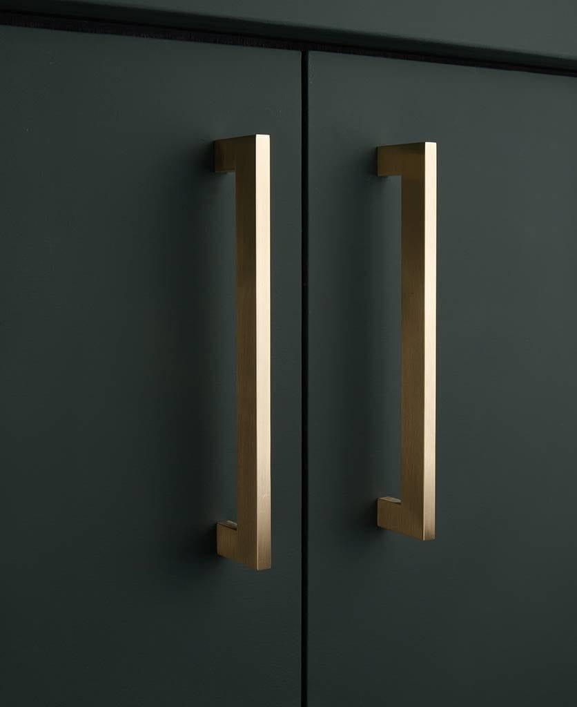 Brass gamma kitchen cupboard handles on dark grey cupboard