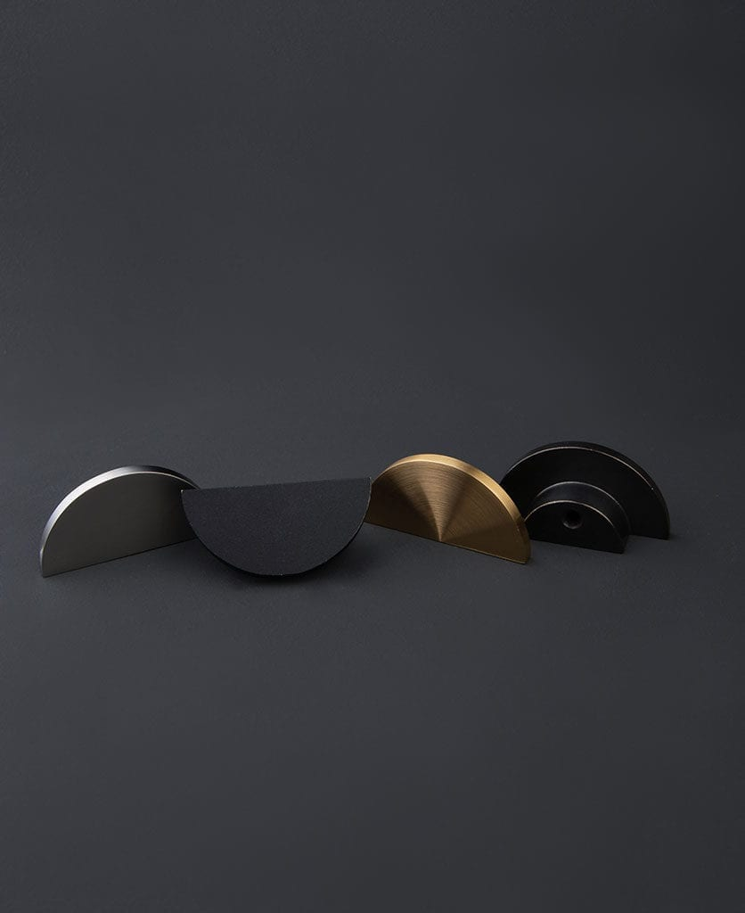 nouveau metal semi circle drawer knob against dark grey background