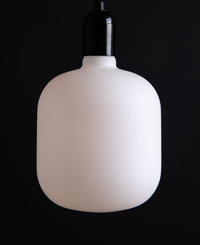 pandora unlit square light bulbs suspended from black bakelite bulbholder against black background