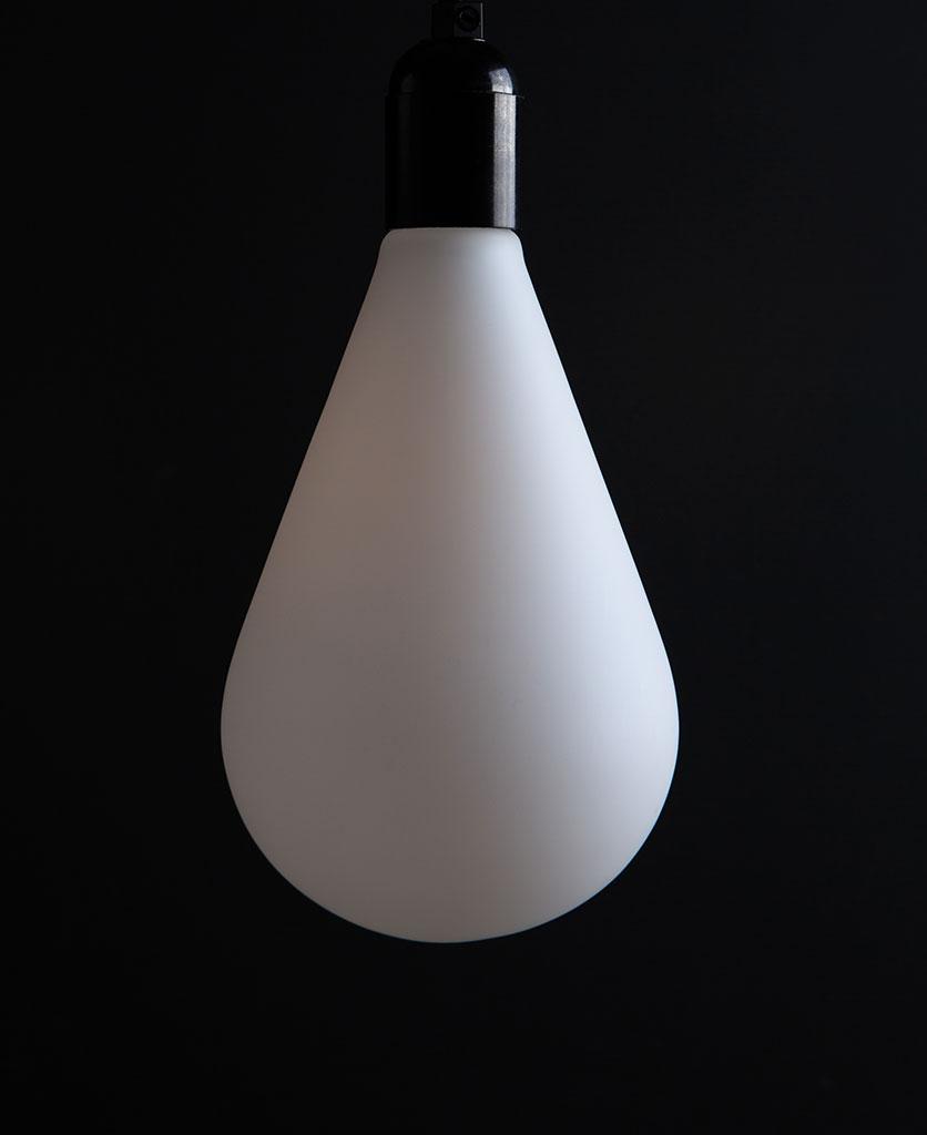 Unlit Celestia decorative bulbs susoended from black bakelite bulbholder on black background