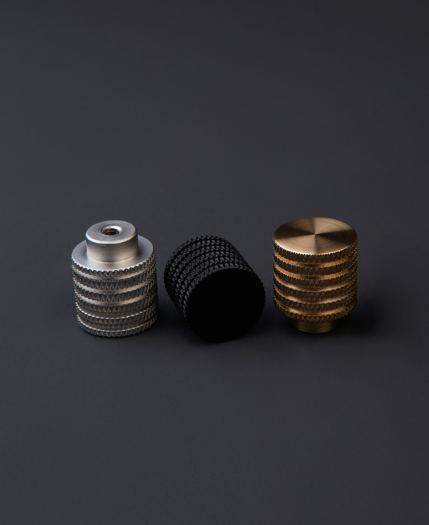 avant garde small drawer handles in black silver and gold against dark grey background