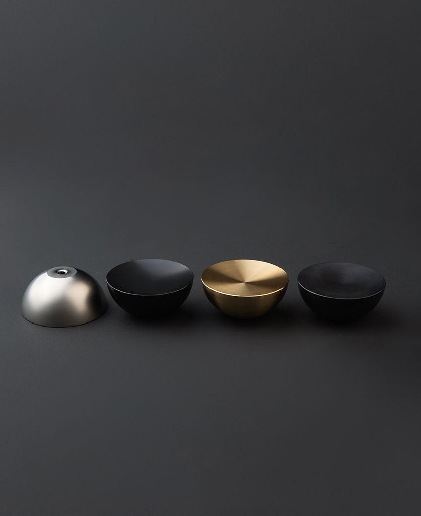 surrealist drawer pull handles group shot with silver, black, antique black and gold knobs on a black background