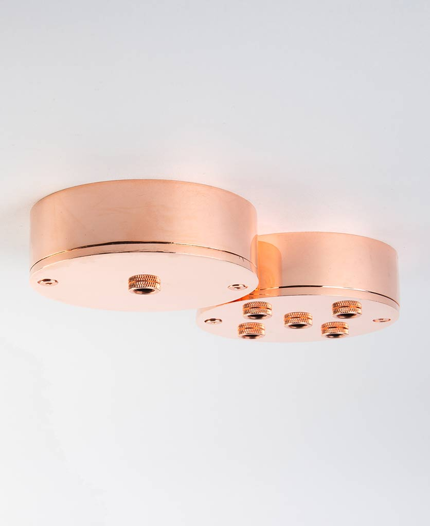 polished copper multi ceiling roses against white background
