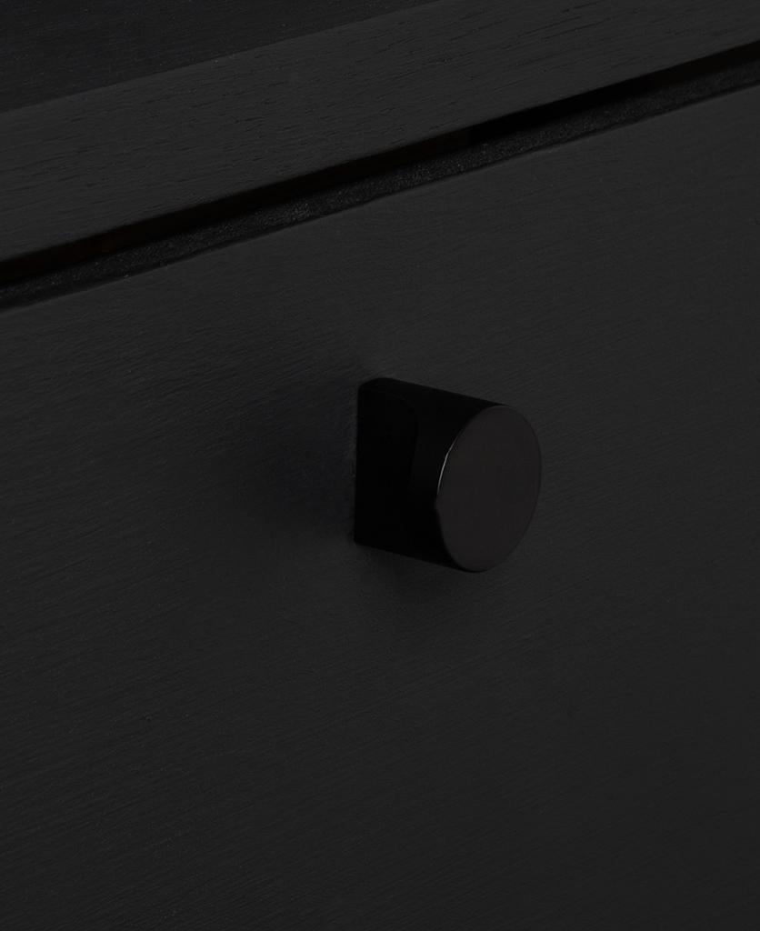 abstract black knob on black drawer