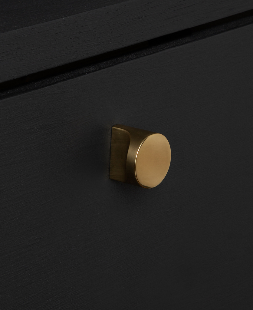 abstract gold knob on black drawer