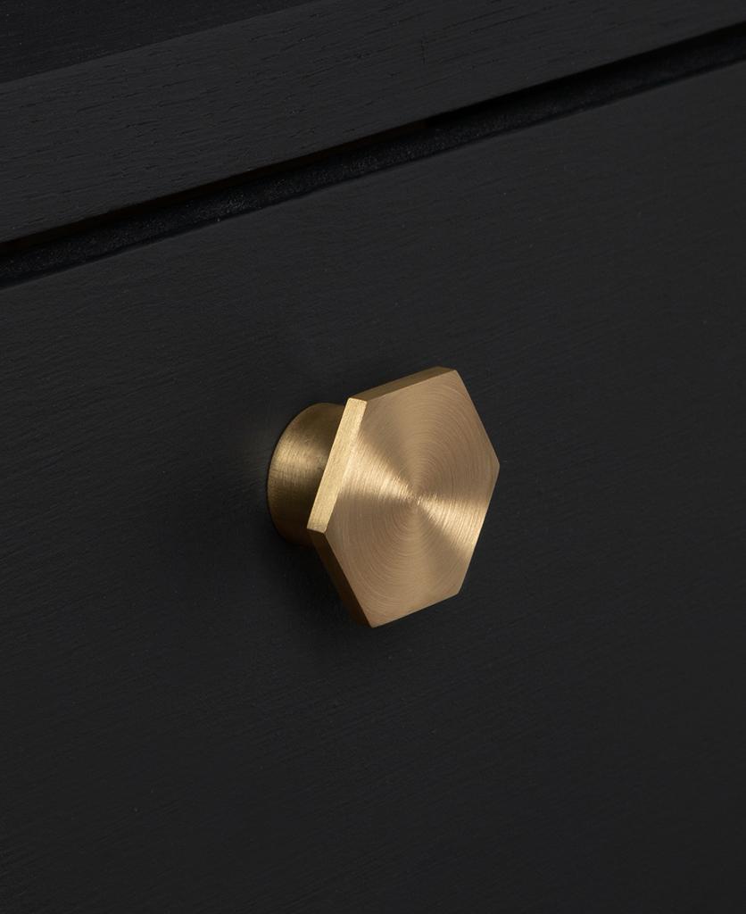 bauhaus gold knob on black drawer