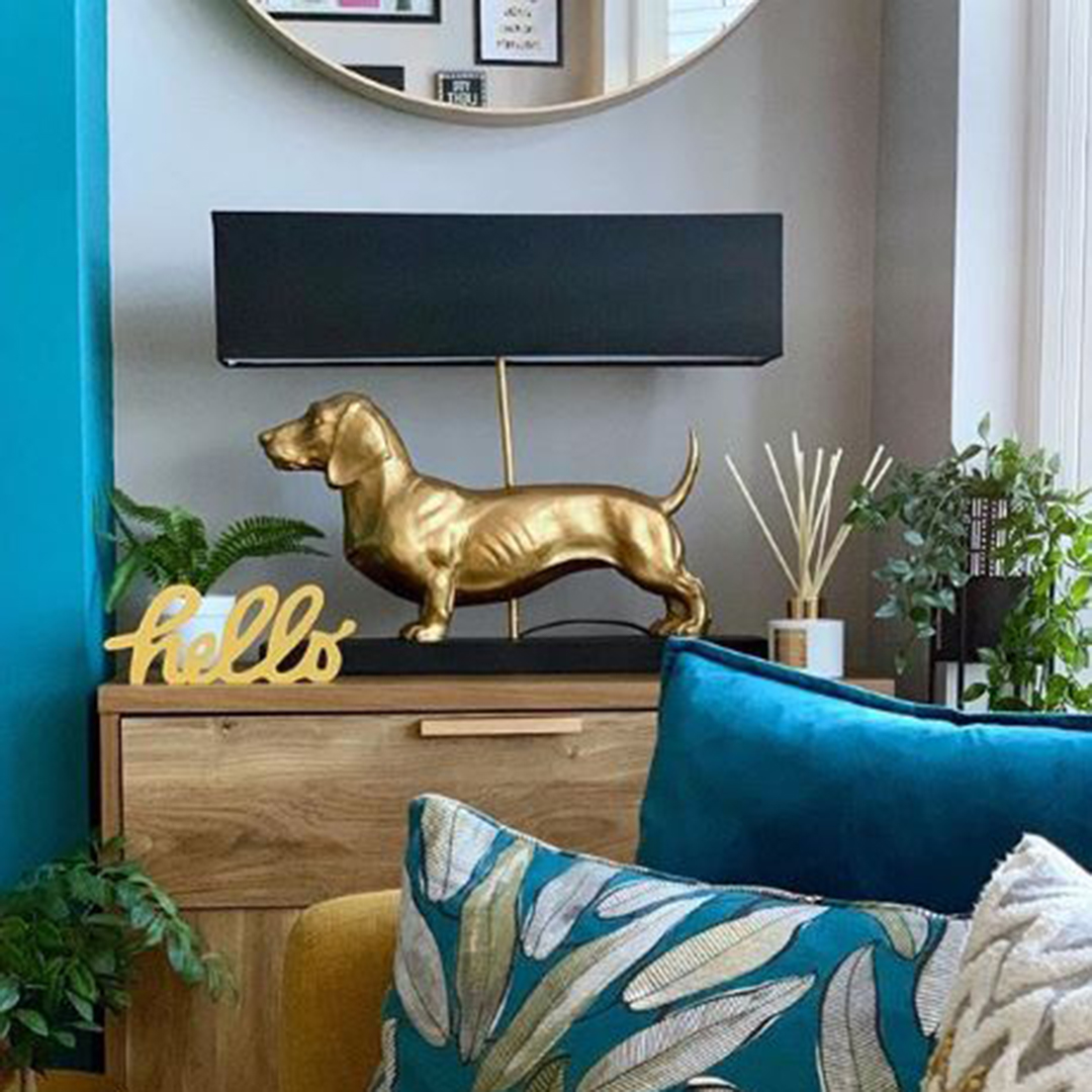 fred dachshund table lamp in a white and blue living room