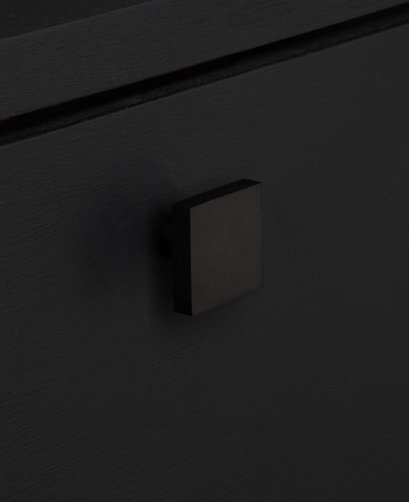 expressionist black knob on black drawer
