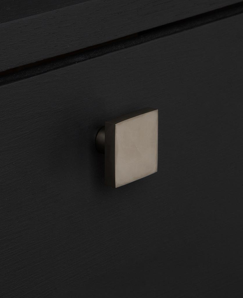 expressionist silver knob on black drawer