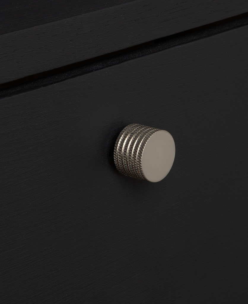 large avant garde silver knob on black drawer